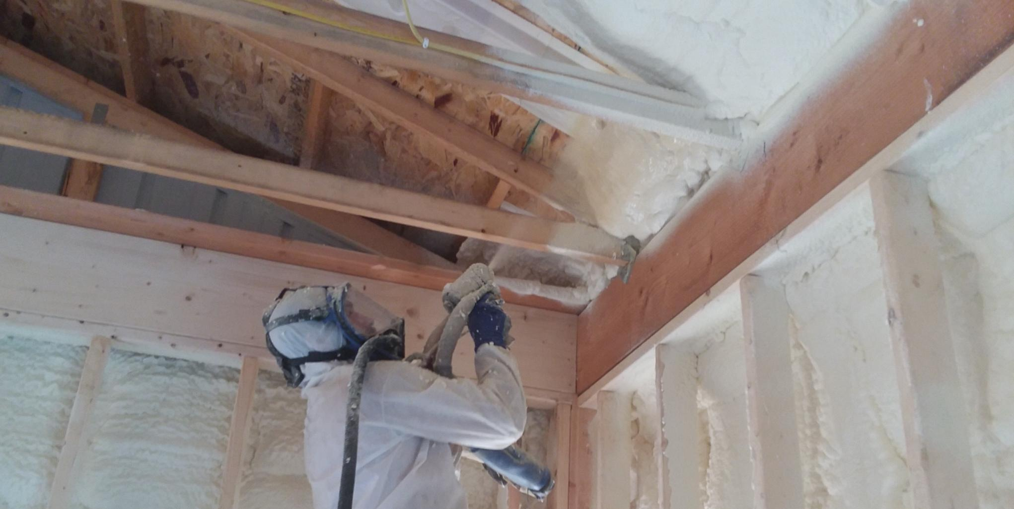 Accurate-Airtight Exteriors Crew Member Applying Spray Foam Insulation