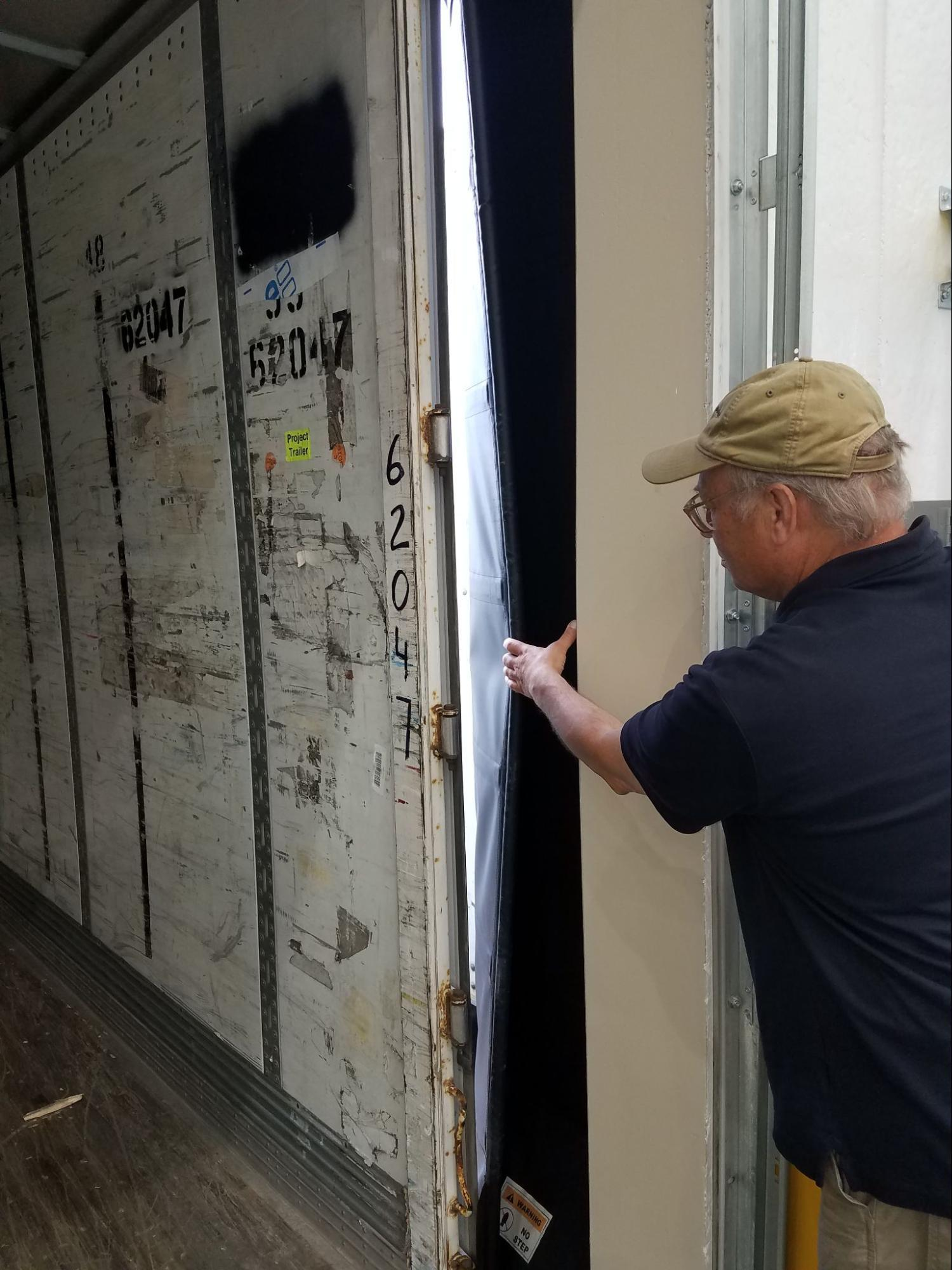 Accurate-Airtight Exteriors Expert Inspecting Commercial Building's Air Barrier