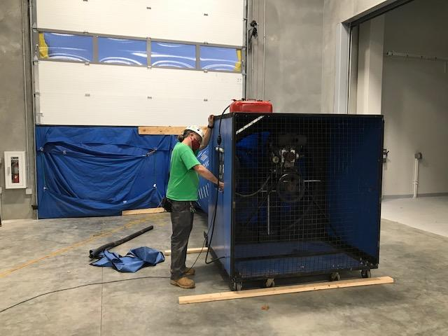 Accurate-Airtight Exteriors Expert Conducting Air Barrier Testing With Commercial Blower Door Equipment