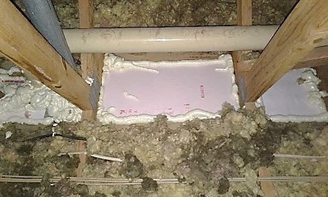 Close-up of caulk on chimney in attic