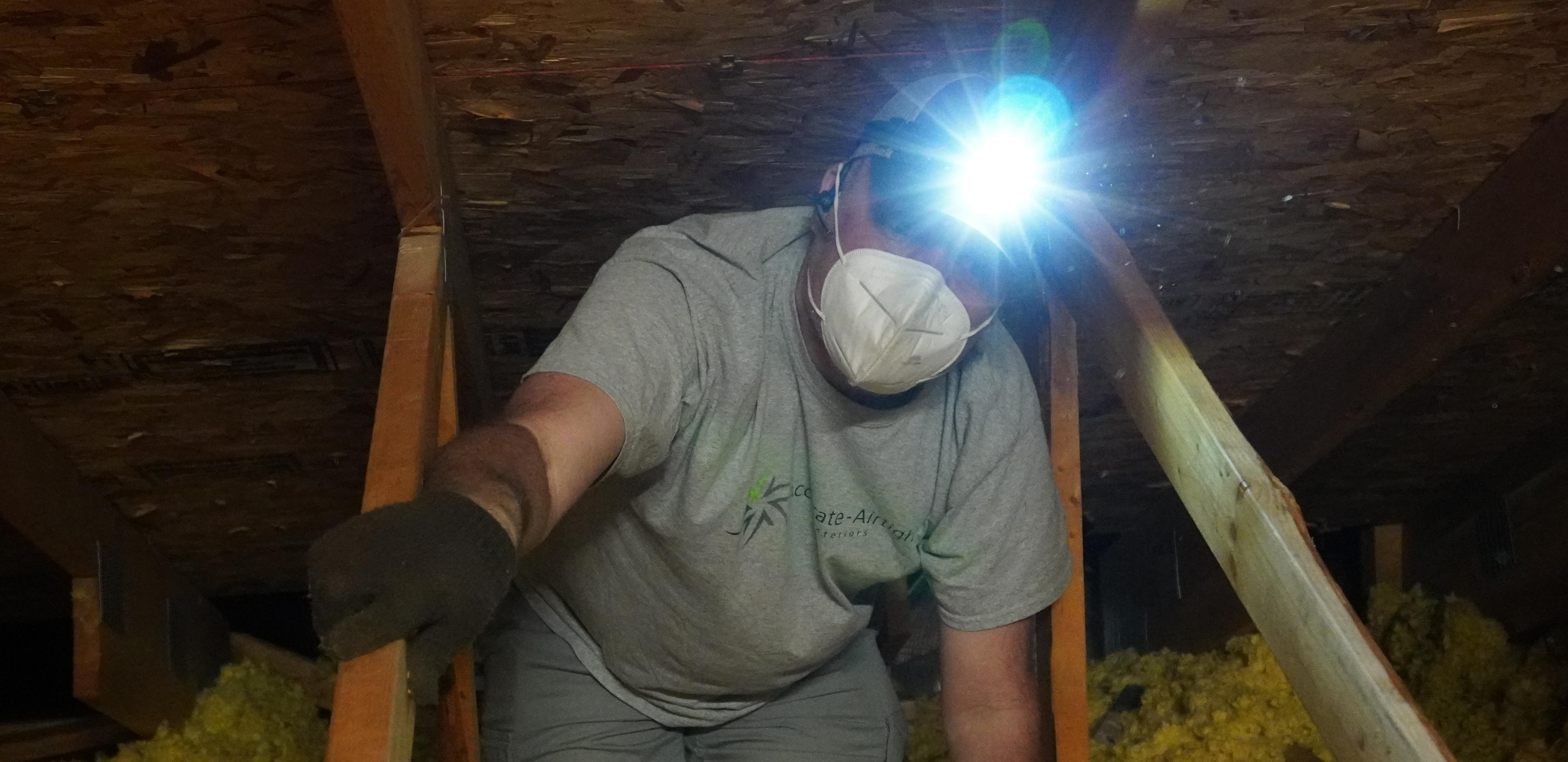 Accurate-Airtight Exteriors Crew Member Wearing A Head Lamp While Working In Attic