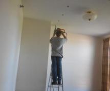 Technician installing insulation