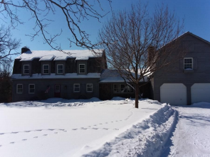 Front view of a snowy home during the winter