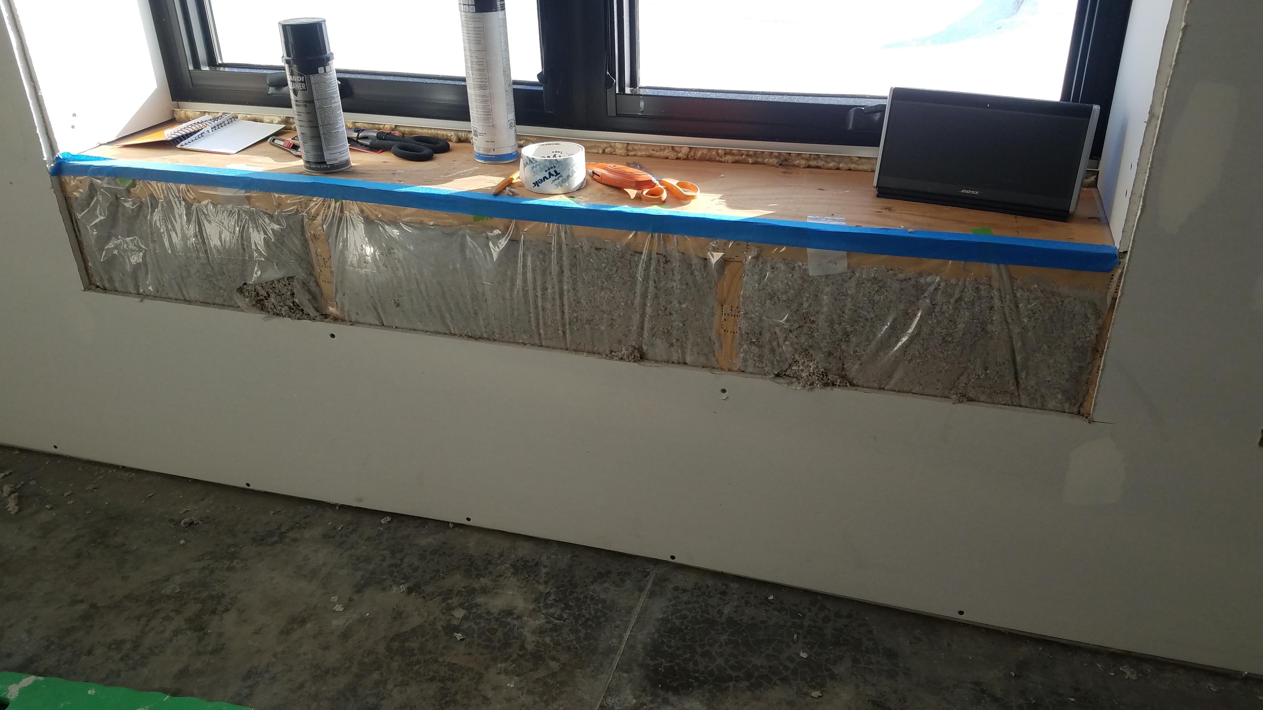 Window sill with freshly installed cellulose insulation